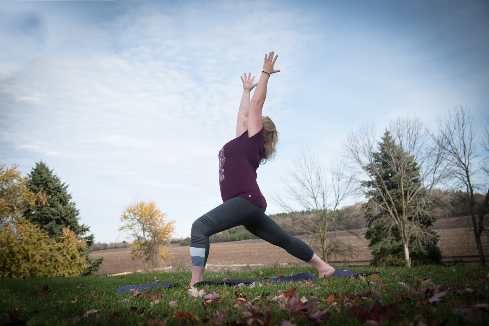 Instructor & Owner Lisa McKernan - High Lunge Pose