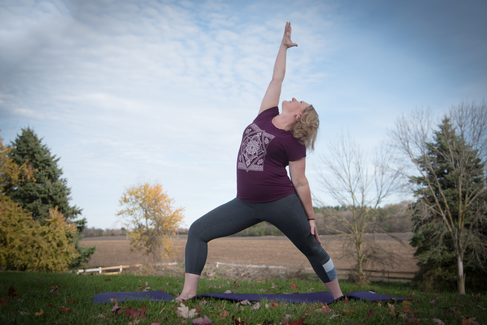 Instructor & Owner Lisa McKernan - Reverse Warrior Pose