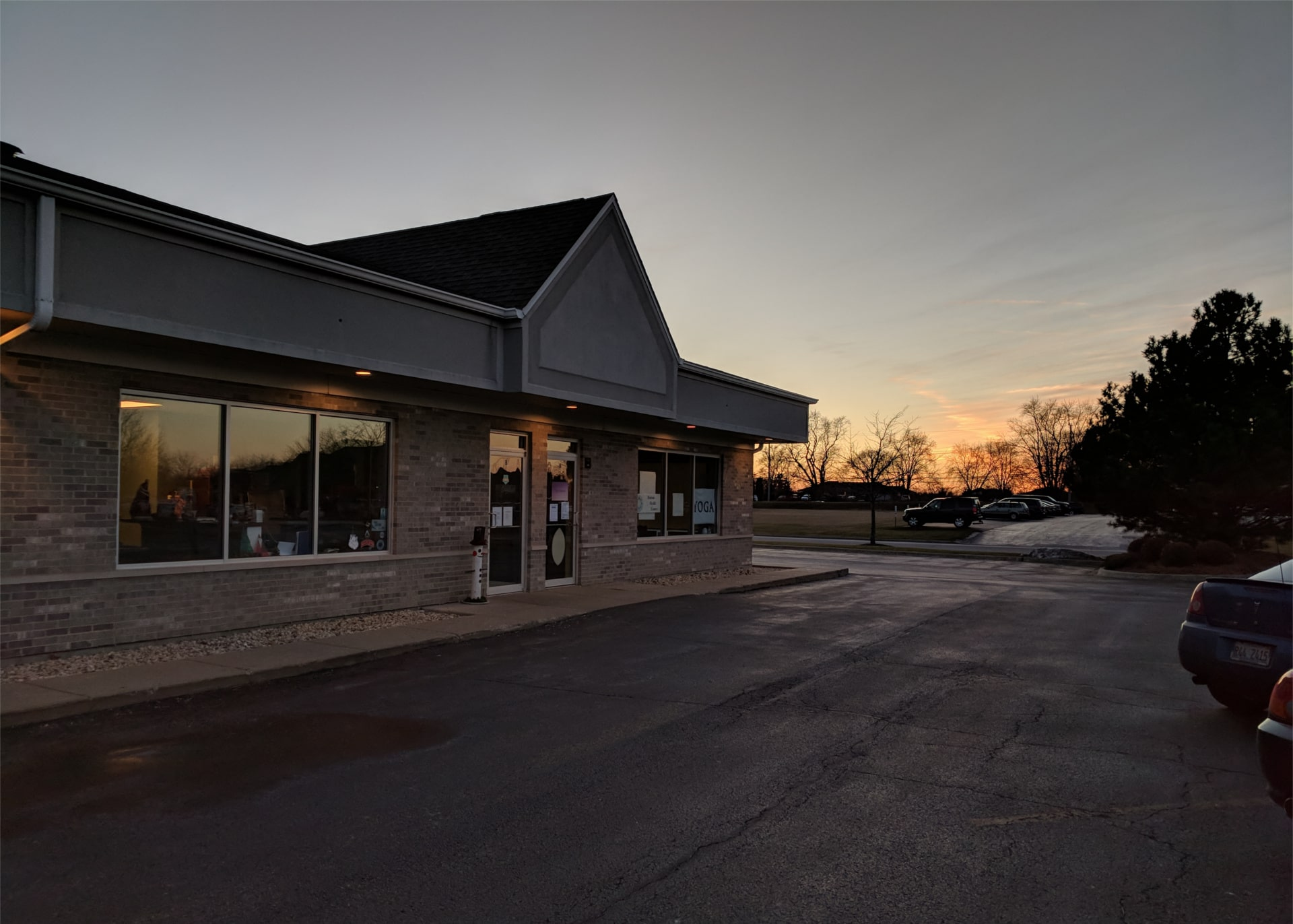 Yoga Balance - Grayslake Building at Sunset